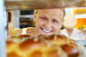 Happy woman looking at fresh bread
