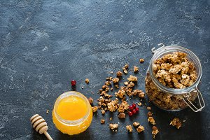 Granola and honey on dark background