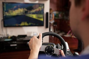 Man playing racing game with
