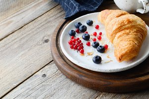 Continental breakfast croissant and berries