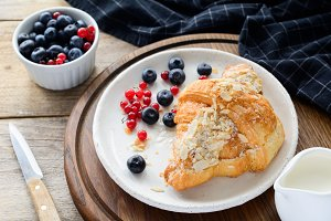 Croissant and berries on plate