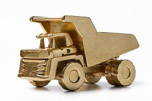 Golden dumper toy made of wood.