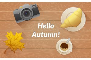 Hallo autumn text. Tasty buttery croissant and cup and camera of hot coffee on old wooden table with yellow leaves. Vector flat illustration