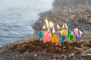 Birthday candles burning on a seasho