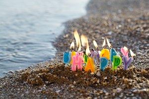 Birthday candles burning on a seasho