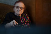 Elderly lady watching television