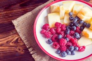 Raspberries, blueberries and melon