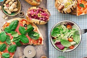 Pizza, hot-dog, salad, wine, beer