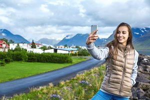 Cheerful woman posing on nature in Iceland