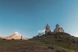 View of Kazbeg mountain and a cross, by the trinity church, Georgia