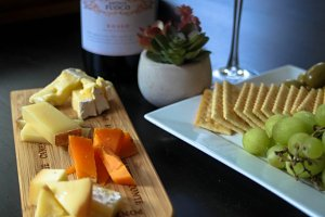 Cheese Board with Wine and Crackers