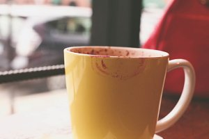 Yellow Coffee Cup with Lipstick Mark