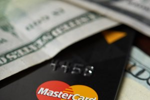 Master card logo in dollar bills