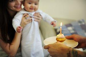 Parents celebrating birthday of baby