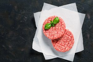 Two raw beef meat steak cutlets for burger with copy space