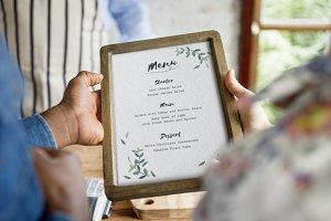 Hands holding menu