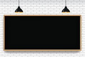 Blank blackboard in white brick wall