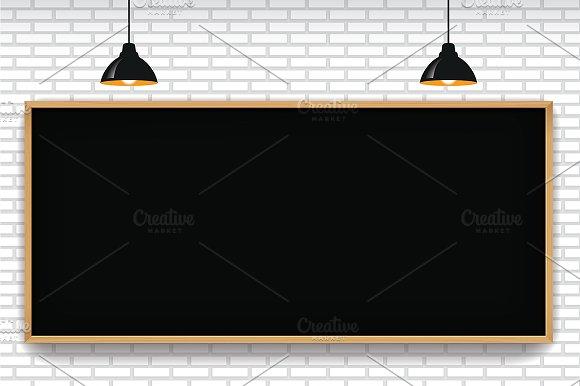 Blank Blackboard In White Brick Wall