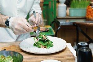 Chef is serving vegetable starter