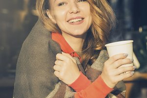 Beautiful young girl drinking coffee