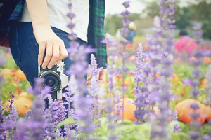 Traveler with film camera in garden