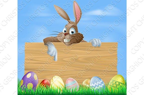 Cartoon Easter bunny pointing