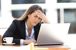 Businesswoman suffering head ache