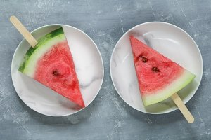 Portion slices of watermelon with wooden . Top view.