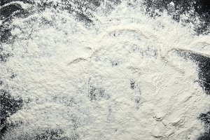 White flour on black background