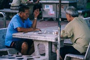 Elderly Men Playing Checkers
