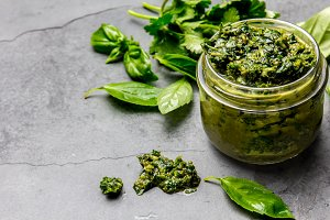 Chimichurri sauce. Argentine green parsley basil sauce chimichurri for barbecue asado in glass jar, gray slate background