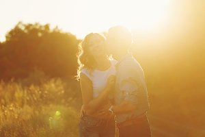 Couple in love at sunset. Kiss