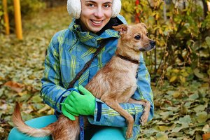 Girl and small dog. Autumn