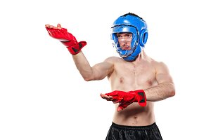 Fighter in sports helmet and gloves