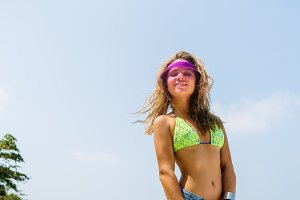 Pretty young woman have fun on beach