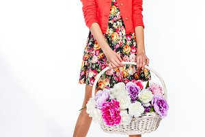 Teen girl holding basket of flowers
