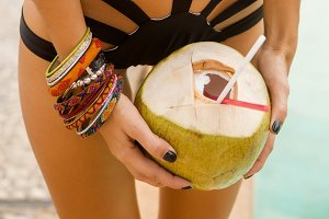 Beautiful girl posing with coconut.