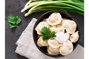 Russian pelmeni, ravioli, dumplings with meat
