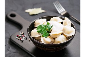 Russian pelmeni, ravioli, dumplings with meat