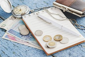 Polish zloty with little wallet, notebook and pocket clock