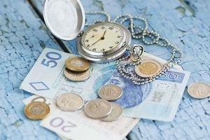 Polish zloty and a pocket clock