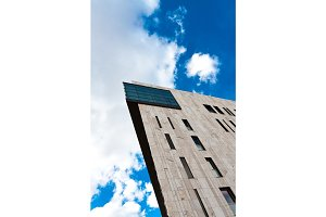 Modern building angle shot against blue sky