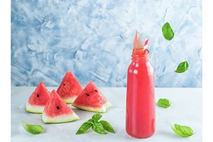 Splashes of watermelon lemonade in mason jar