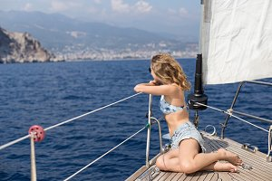 fit blonde woman enjoying sailing