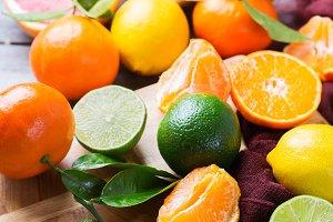 Citrus fruits background. Orange, grapefruit, tangerine, lime, lemon vitamin