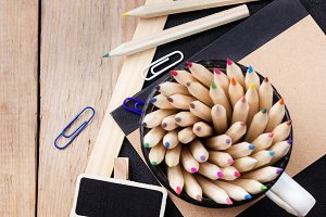 Business accessories, supplies, mug with pencils on rustic wooden table