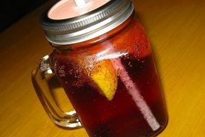 Cherry lemonade cocktail in glass jar mug straw summer macro photo