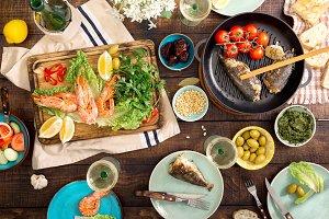Shrimp, fish grilled, salad, snacks