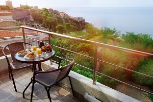 Table with fresh breakfast served at the terrace