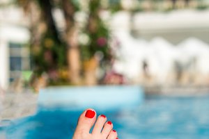 Woman's feet relaxed in swimming pool